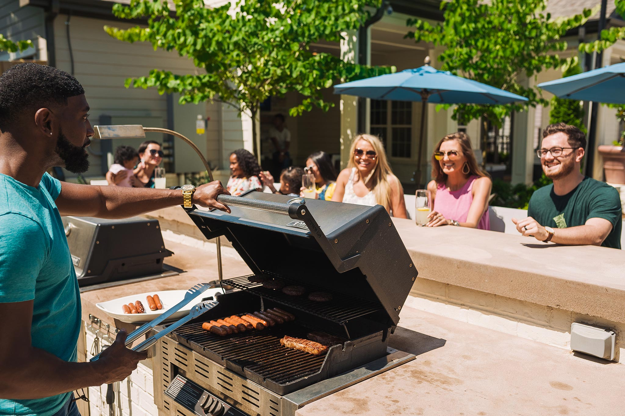 image of people enjoying a barbecue with outside amenities